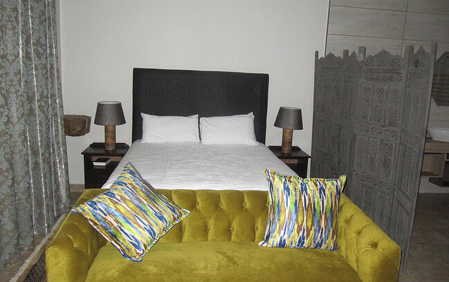 Bedroom with yellow couch At The Rocks
